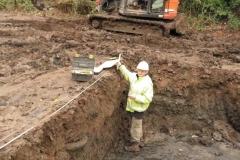 5 Archeologist taking measurement
